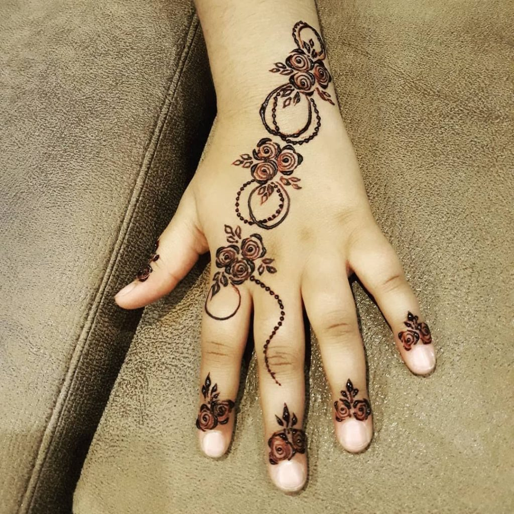 15+ Unique Mehendi Designs for Kids Hands– Check Out Now!, Fancy Flower Roll