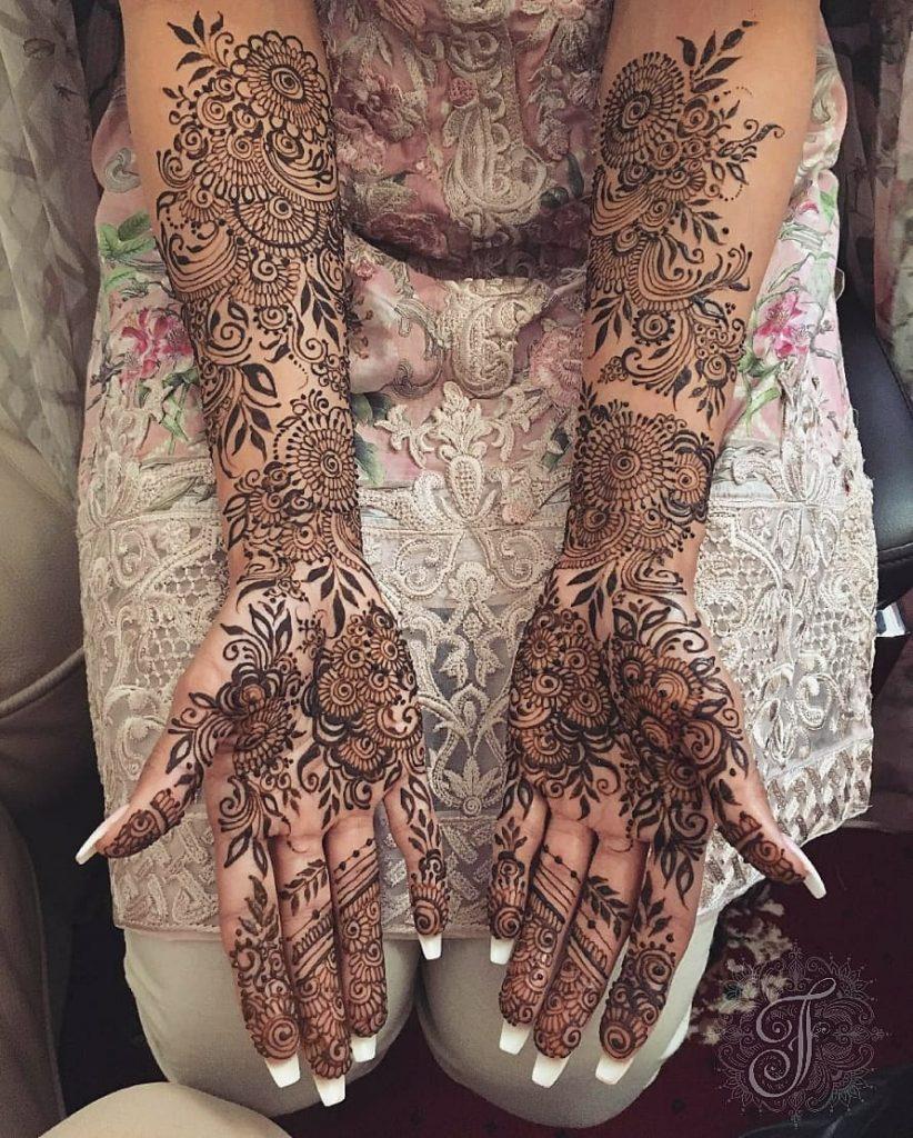 10 Rockstar Mehendi Artist You Must Follow for your henna Inspo!, Nisha Hussain 1